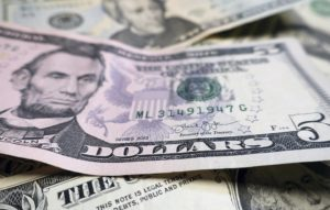 Press review: US sanctions eroding dollar and Japan seeks to build bridges with Russia